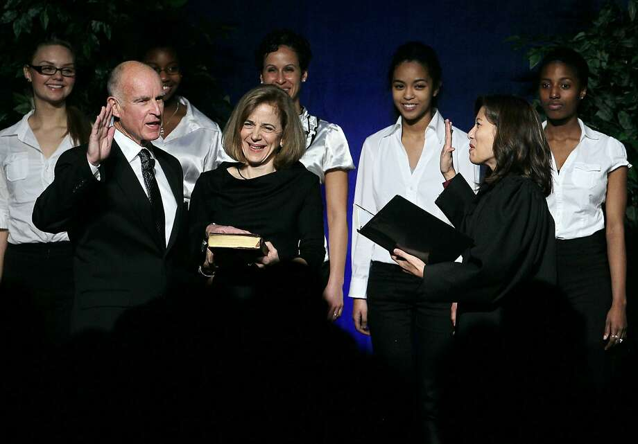 California Gov. Jerry Brown (L) is sworn in as the state's 39th governor by California Chief Justice Tani Cantil-Sakauye (R) as Brown's wife, Anne Gust-Brown (C), looks on January 3, 2011 in Sacramento. Photo: Justin Sullivan, Getty Images