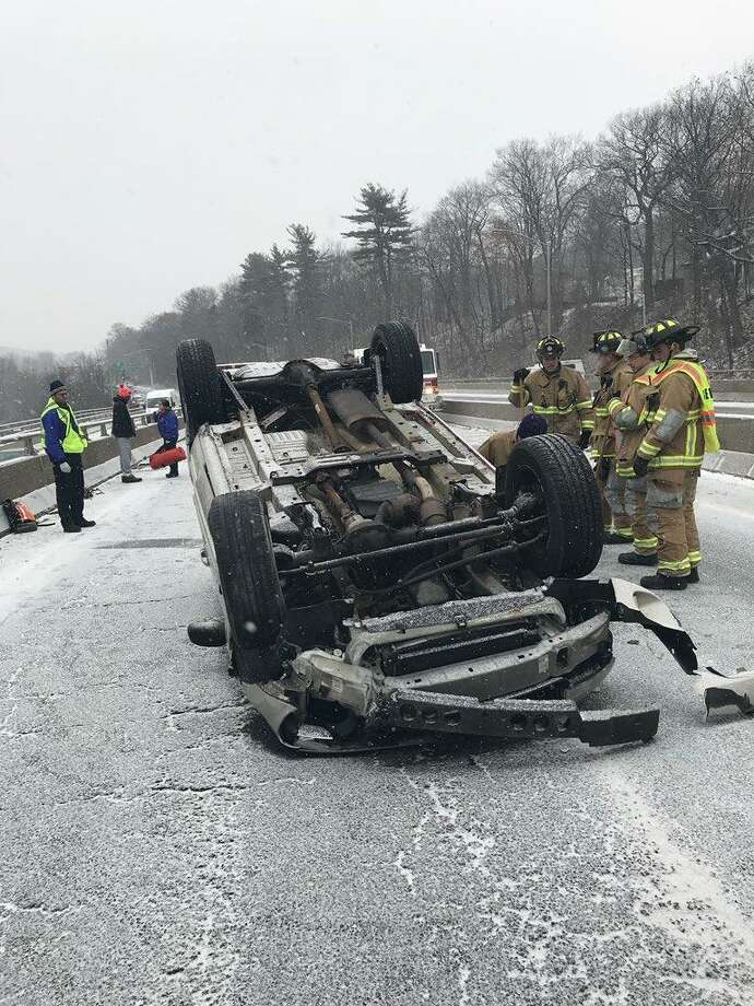 This accident happened on southbound Route 8 in Naugatuck on Saturday, Dec. 30, 2016. State Police said there was a nearly 80 percent increase in the number of accidents during the New Year's weekend from a year earlier. Photo: State Police Photo