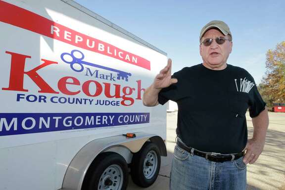 State Rep. Mark Keough talks as he prepares to put out campaign signs Wednesday, Dec. 20, 2017, in Conroe. He is running against Montgomery County Judge Craig Doyal in the Republican primary.