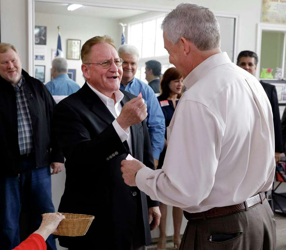 State Rep. Mark Keough holds up his number two as he jokes with Judge Craig Doyal after Doyal drew the number one ballot position at the Montgomery County Republican Party office in Conroe, Dec. 21. (Michael Wyke / For the  Chronicle) Photo: Michael Wyke, For The Chronicle / © 2017 Houston Chronicle
