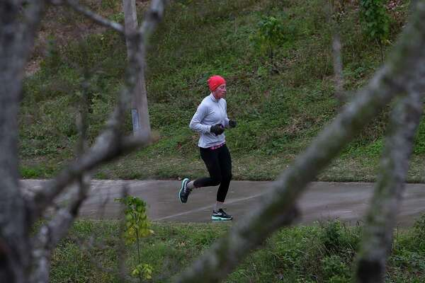 A woman runs along the Buffalo Bayou in the cold weather Tuesday, Jan. 2, 2018, in Houston. Houstonians woke up to cold weather, with the temperature in the high 20s.