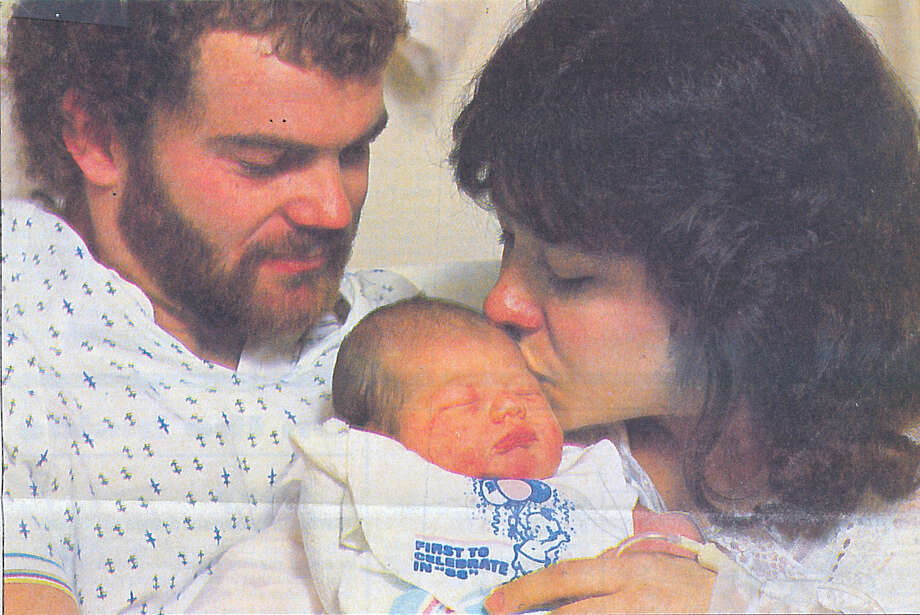 Dwayne and Cindy Going, of Nome, hold their daughter, Megan, on New Year's Day in 1988. Megan was Beaumont's first baby of the year. Enterprise file photo Photo: Ryan Pelham / ©2017 The Beaumont Enterprise/Ryan Pelham