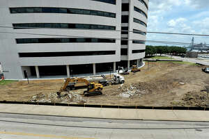 Workers remove the last bits of rubble at the Edison Plaza on Monday. The front of the facility is expected to receive a make over. Photo taken Monday, June 4, 2012 Guiseppe Barranco/The Enterprise