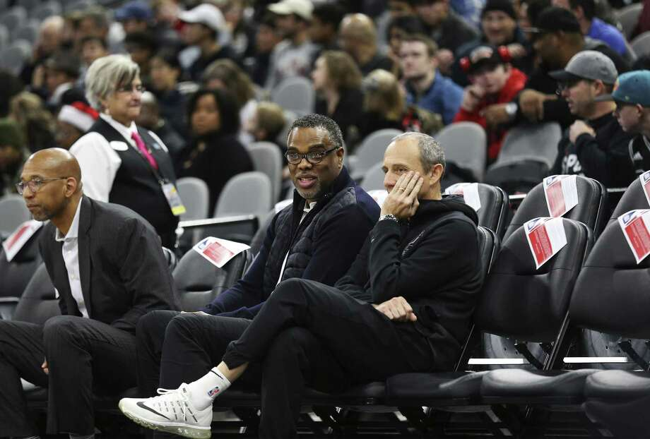 Spurs assistant coach Ettore Messina (right) chats with Roger Montgomery of Roc Nation Sports before a recent game. The Spurs announced Thursday morning that Messina will coach the Spurs following the death of head coach Gregg Popovich's, wife, Erin. Photo: Kin Man Hui /San Antonio Express-News / ©2017 San Antonio Express-News