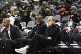 Spurs assistant coach Ettore Messina (right) chats with Roger Montgomery of Roc Nation Sports before a recent game. The Spurs announced Thursday morning that Messina will coach the Spurs following the death of head coach Gregg Popovich's, wife, Erin.