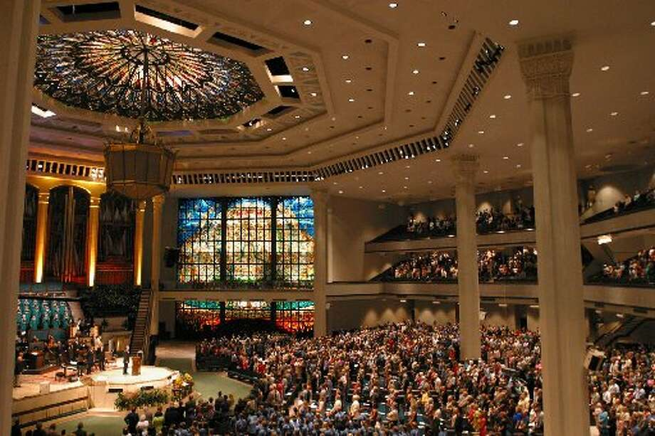 About 5,000 people attend a service at Second Baptist church in Houston. An opulent chandelier hangs from a rounded ceiling and a loft that can squeeze in 500 choir members. (AP Photo/Michael Stravato)