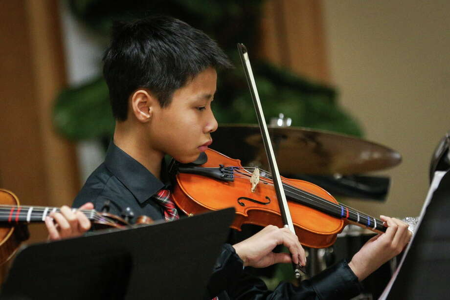 Eric Zhou plays violin during the Conroe Symphony Youth Orchestra Christmas Concert on Sunday, Dec. 17, 2017, at the Conroe Symphony Centre. The spring season for the Conroe Symphony Youth Orchestra begins on Jan. 7. Photo: Michael Minasi, Staff Photographer / © 2017 Houston Chronicle