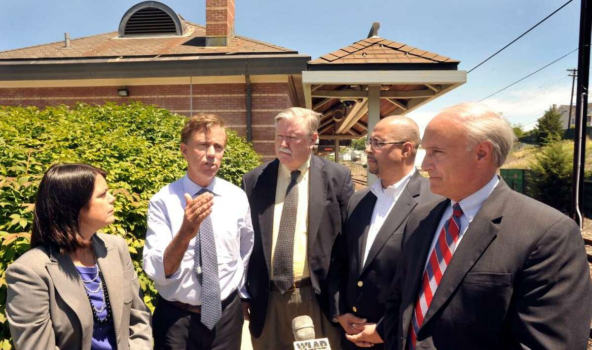 Ned Lamont, a Democrat who is a candidate for governor, speaks at the Danbury train station on Wednesday, June 30, 2010. Also attending the press conference are Mary Glassman, first selectwoman of Simsbury and a Democratic candidate for lieutenant governor, left, Jim Maloney, former U.S. congressman, center, State Rep. Jason Bartlett, D-Bethel, and Rudy Marconi, first selectman of Ridgefield, right.