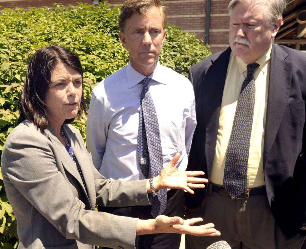 Mary Glassman, first selectwoman of Simsbury and a Democratic candidate for lieutenant governor speaks a press conference at the Danbury train station on Wednesday, June 30, 2010. At center is Ned Lamont, a Democrat who is candidate for governor, at right is Jim Maloney, former U.S. congressman.