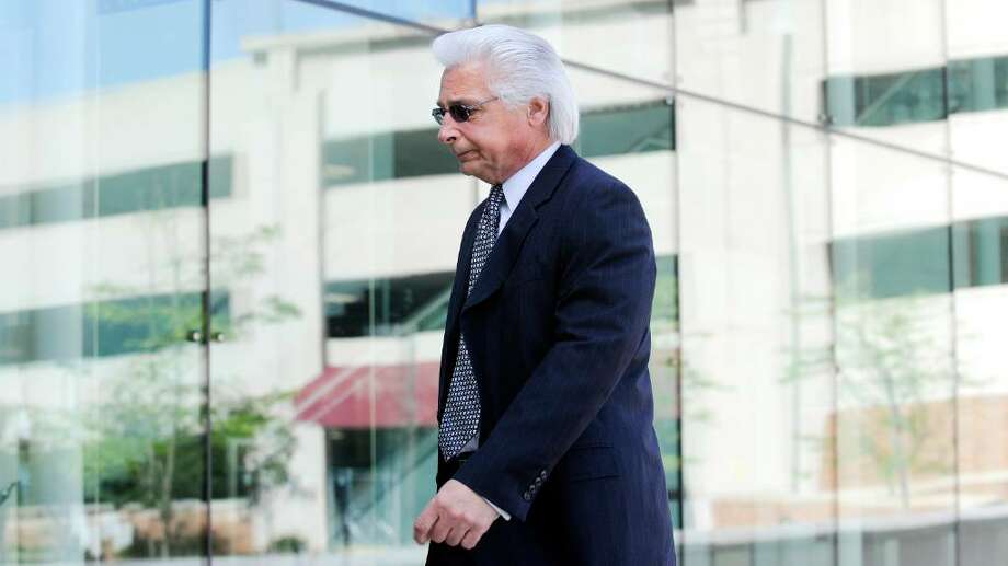 Stamford human resources specialist Fred Manfredonia, 59, arrives at State Superior Court in Stamford to face a single count of first-degree larceny and five counts of third-degree forgery May 13, 2010. Photo: File Photo / Stamford Advocate File Photo