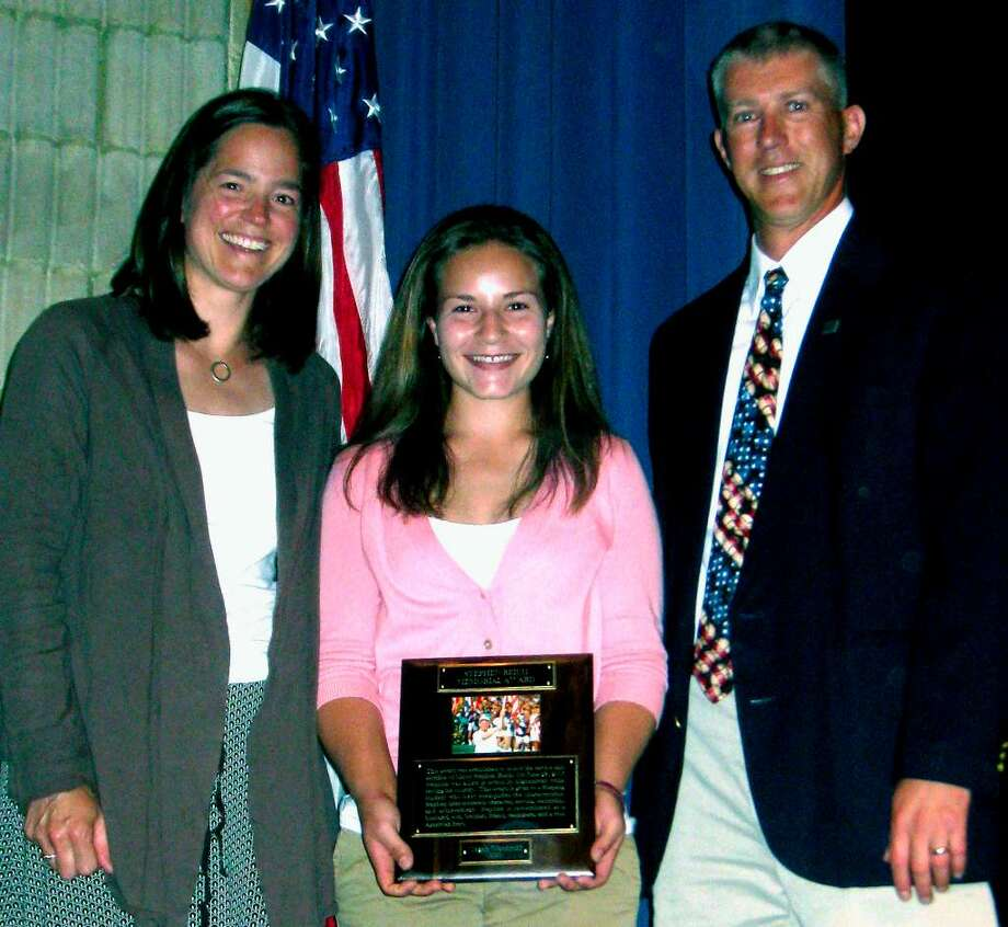 SPECTRUM/Shepaug Valley High School senior Megan Woodruff is the fifth winner of the annual Major Stepeh Reich Award, given in memory of the late Shepaug Valley High and West Point graduate. Presenting the award is Maj. Reich's sister, Megan (Reich) George, and close friend Scott Werkhoven. May 27, 2010 Photo: Norm Cummings / The News-Times