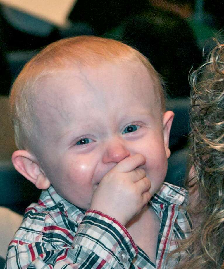 SPECTRUM/Daniel McKenna, the 15-month-old son of New Milford High School adult education graduate Taylor Hildebrandt, enjoys her graduation ceremony, June 19, 2010 at NMHS Photo: Trish Haldin / The News-Times Freelance