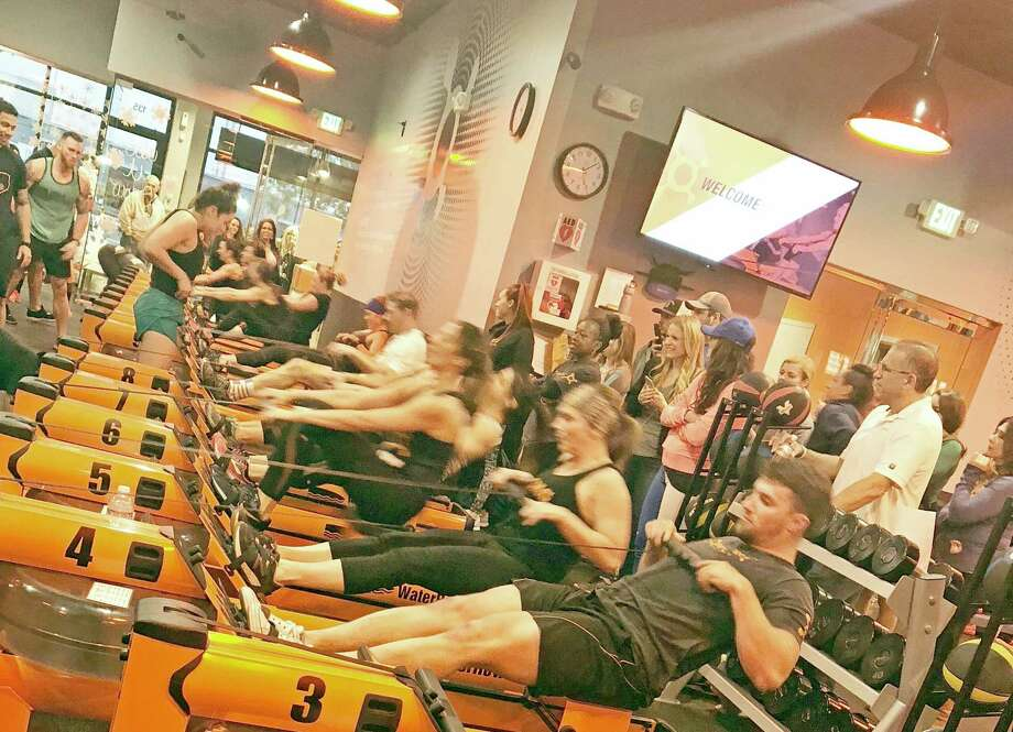 For 12 days at the beginning of December, members at Sugar Land and Houston-area Orangetheory Fitness Studios were able to turn the tables on their trainers by assigning certain designated exercise, such as rowing, in return for $1 donations for each exercise. In total, Sugar Land trainers raised $2,935 of an overall $53,400 donation raised in combination with 13 Houston-area locations this year. Photo: Courtesy Of Orangetheory Fitness Studios