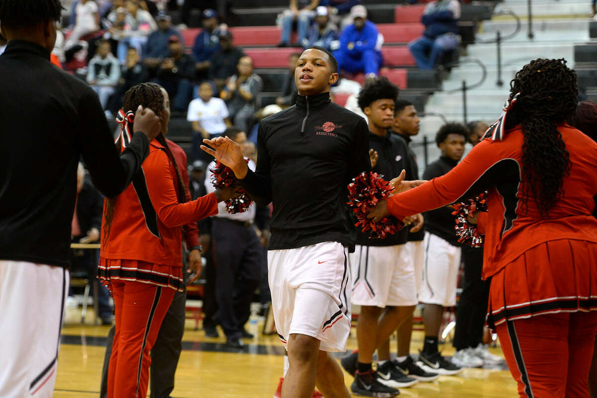 Memorial's starting line up is announced before playing Ridge Point in the championship game of the James Gamble Classic tournament at Memorial High School on Saturday night. Photo taken Saturday 12/30/17 Ryan Pelham/The Enterprise
