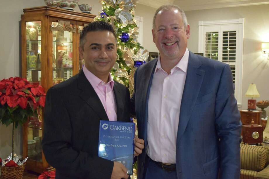 Dr. Sarfraz Aly, Physician of the Year and Joe Freudenberger, CEO OakBend Medical Center Photo: OakBend Medical Center