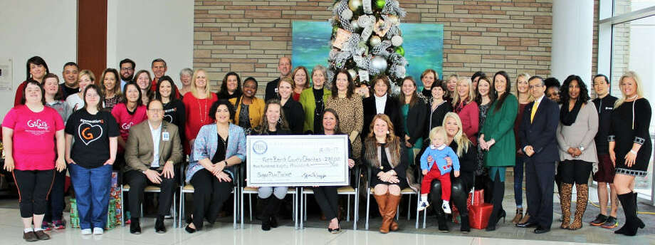 Representatives of the organizations receiving proceeds from the 2017 Sugar Plum Market joined members of the Fort Bend Junior Service League and representatives of Memorial Hermann on December 15th to celebrate the Market's success. Photo: The Fort Bend Junior Service League