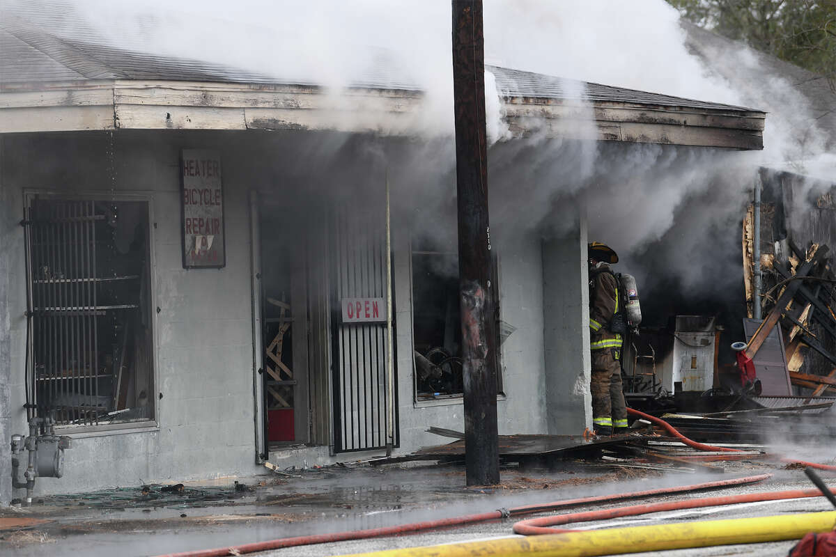 Beaumont firefighters battle fire and freezing temperatures at an abandoned bicycle repair store on Park Street Tuesday morning. The building was empty at the time of the fire and no injuries were reported. An investigation to the cause of the fire is ongoing. Photo taken Tuesday, January 02, 2018 Guiseppe Barranco/The Enterprise