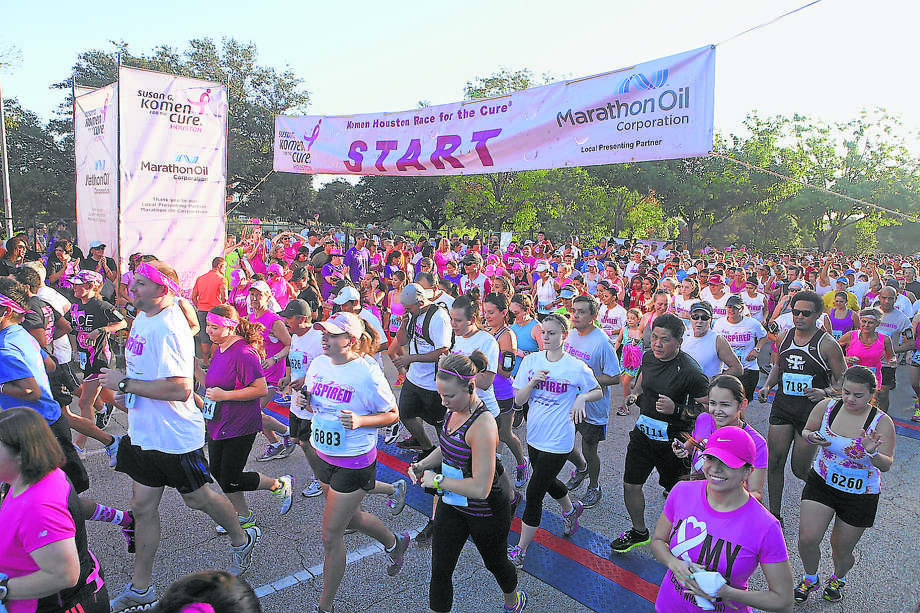 Runners start at the Komen Race for the Cure in Houston on Oct. 5, 2013. Photo: Photo By Alan Warren, Staff Photographer / Internal