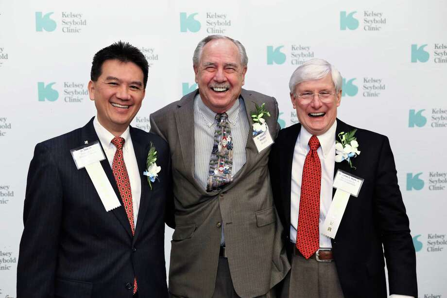 Every year, Kelsey-Seybold Clinic hosts a luncheon that celebrates employees who have served a milestone number of years, starting at 15 years. One hundred and fifty-eight employees were honored at the event on Dec. 6. Dr. David Mouton, M.D., an Internal Medicine physician at Tanglewood Clinic, celebrates a 45-year legacy at Kelsey-Seybold Clinic. Pictured from left are Tony Lin, M.D., F.H.M., Chairman and Managing Director, David Mouton, M.D., Internal Medicine, and James Hoyle, M.D., F.A.A.P., F.S.A.H.M., Medical Director of Clinical Operations. Photo: Courtesy Of Kelsey-Seybold Clinic