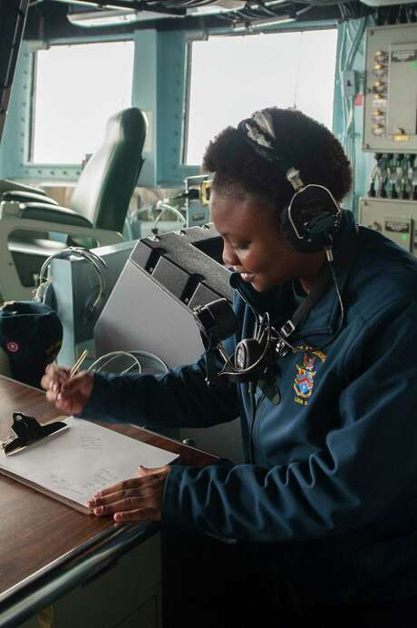 Operations Specialist 2nd Class Trascion Stokes, a Houston native, assigned to the operations department aboard the amphibious assault ship USS America (LHA 6), records surface contacts on the bridge. America is the flagship for the America Amphibious Ready Group and, with the embarked 15th Marine Expeditionary Unit, is deployed to the U.S. 5th Fleet area of operations in support of maritime security operations to reassure allies and partners and preserve the freedom of navigation and the free flow of commerce in the region. Photo: U.S. Navy Photo By Mass Communication Specialist Seaman Daniel Pastor, U.S. Navy Photo By Mass Communic / for public domain