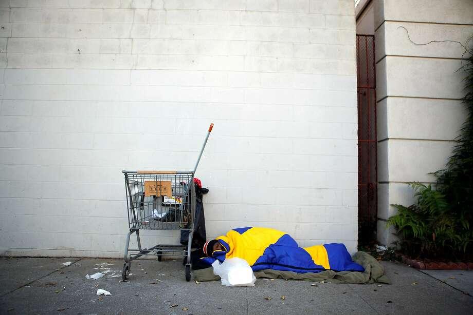 Homeless man sleeps on Octavia Street sidewalk. Photo: Michael Short, The Chronicle