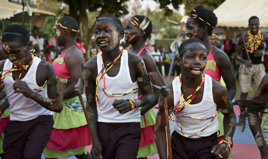 Former child soldiers of the Lord's Resistance Army dance at a therapy program in Gulu, Uganda. Photo: Adelle Kalakouti, Associated Press