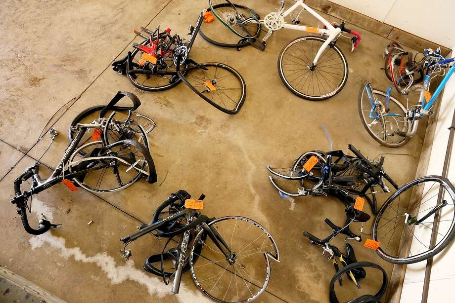 Mangled bicycles are tagged as evidence at the Michigan State Police crime lab in Kalamazoo. State lawmakers are seeking some of the nation's strictest bike-safety regulations. Photo: Mark Bugnaski, Associated Press