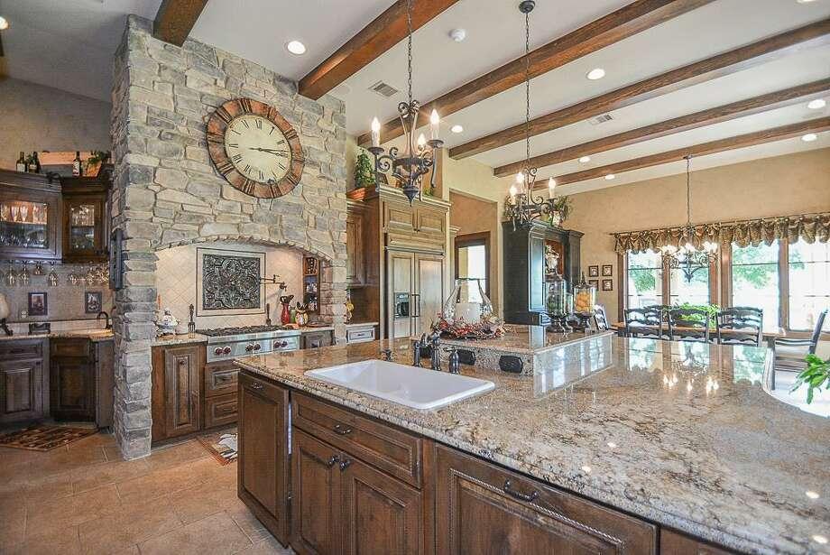 5002 Shiloh Lake Drive, RichmondMain kitchen with oversized granite island.See the listing at HAR.com Photo: Courtesy Terri Kurkjian/ RE/MAX Fine Properties