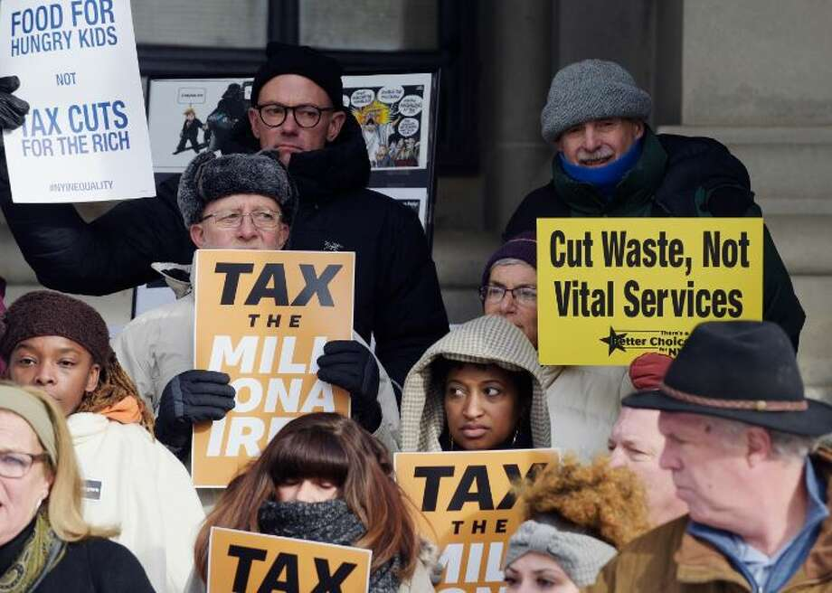 Progressive activists gather outside the Capitol calling for higher taxes on the wealthiest New Yorkers to help the needy Photo: Paul Buckowski/Times Union