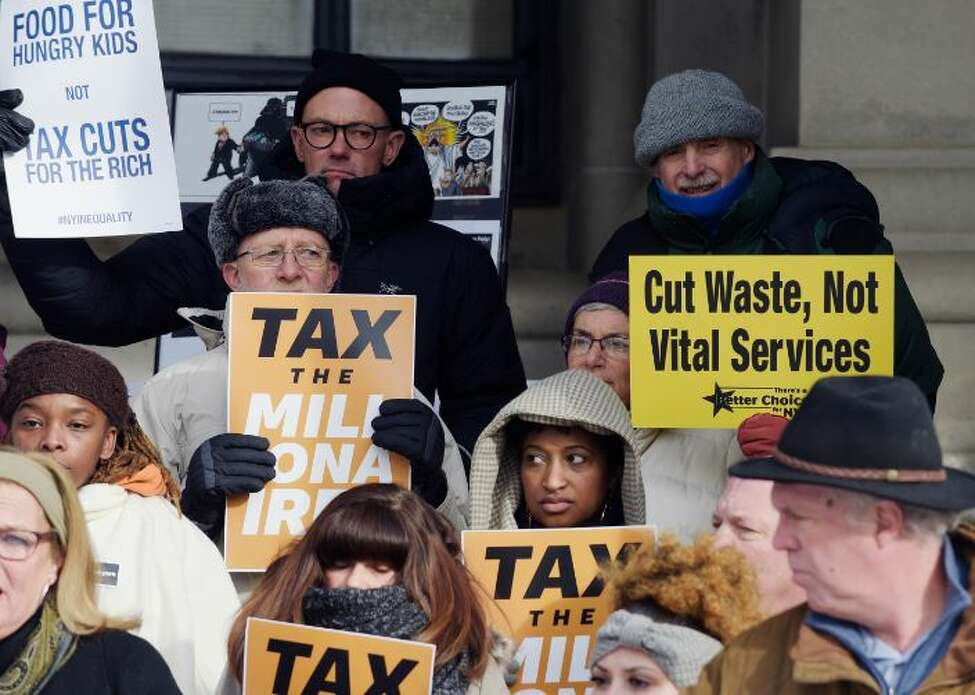 Progressive activists gather outside the Capitol calling for higher taxes on the wealthiest New Yorkers to help the needy