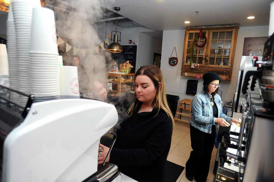 Humbled Coffeehouse barista Tavia DeFranco makes a cappucino for a customer inside the coffee shop at 575 Hope St., in Stamford, Conn. on Monday, Dec. 18, 2017. Photo: Michael Cummo / Hearst Connecticut Media / Stamford Advocate