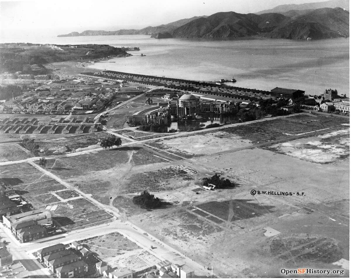 An aerial view over the Palace of Fine Arts and burgeoning Marina District in San Francisco in 1918. The Palace of Fine Arts was built three years prior for the1915 Panama-Pacific Exposition. Photo courtesy of OpenSFHistory.