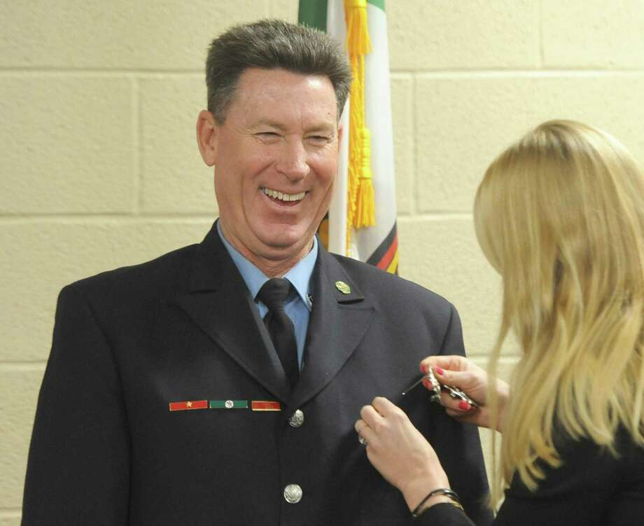 John Kiernan has his badge pinned on by his daughter, Kara Kiernan, during his swearing-in ceremony as new Fire Marshal at the Public Safety Complex in Greenwich, Conn. Tuesday, Jan. 2, 2018. Photo: Tyler Sizemore / Hearst Connecticut Media / Greenwich Time