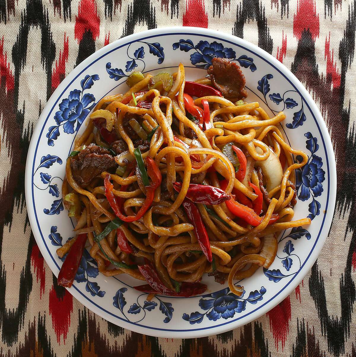 Stir fried noodles with vegetables & beef at Sama Uyghur, one of the only Uyghur (northwest Chinese and Muslim) restaurants in the Bay Area on Monday, December 18, 2017, in Union City, Ca.