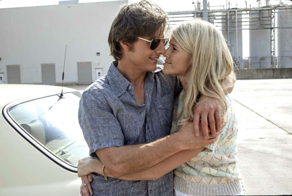 This image released by Universal Pictures shows Tom Cruise, left, and Sarah Wright Olsen in a scene from,