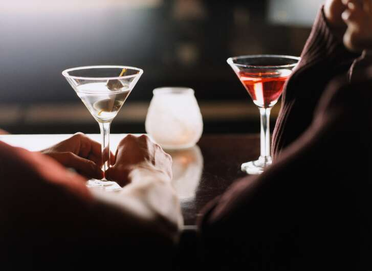 Male Couple at Bar Drinking Martinis and Talking