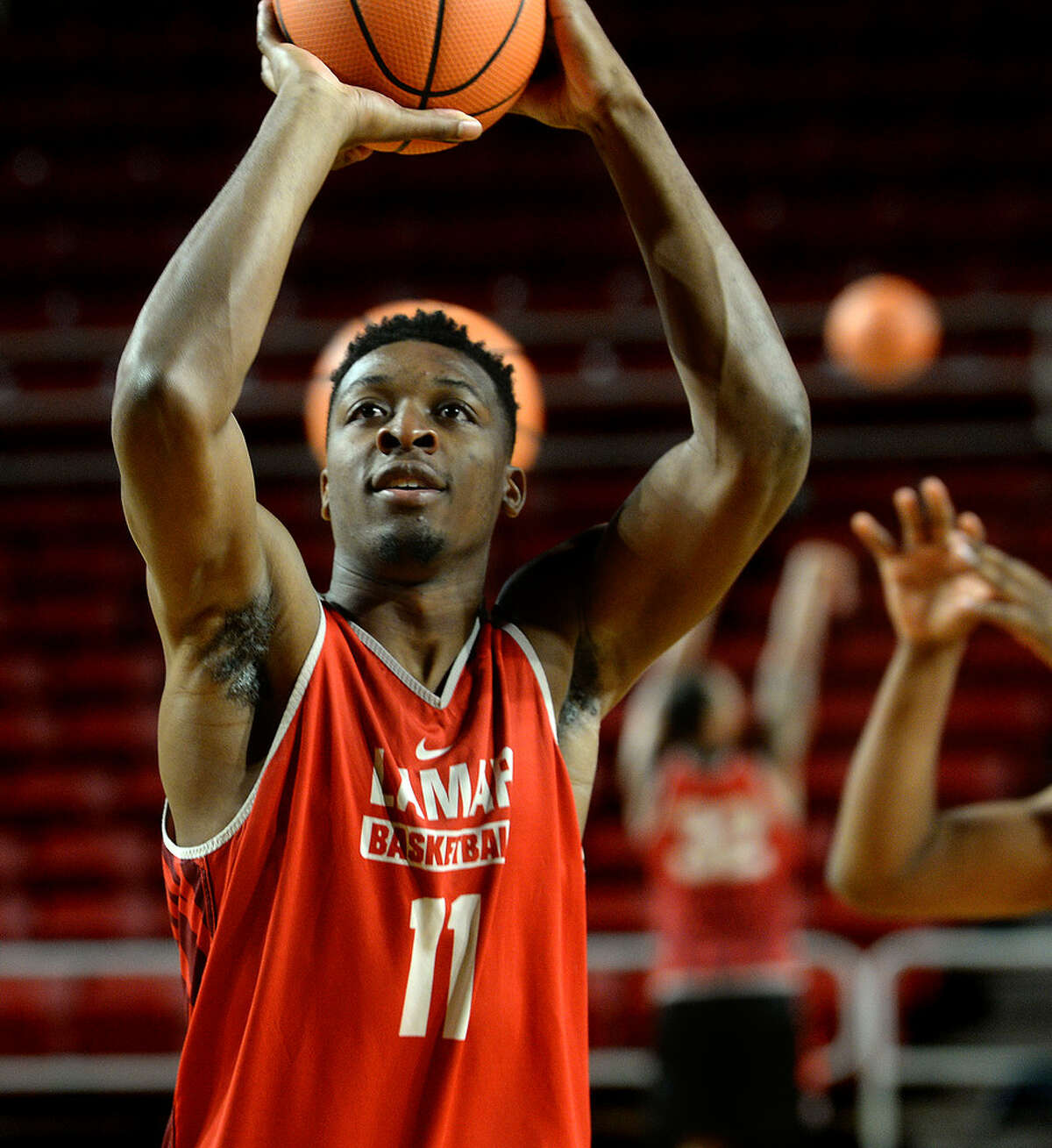 Lamar's Josh Nzeakor gets in shooting practice with teammates Tuesday. The 6-foot-8, Nzeakor is the Cardinal's strongest option at post. Photo taken Tuesday, November 21, 2017 Kim Brent/The Enterprise