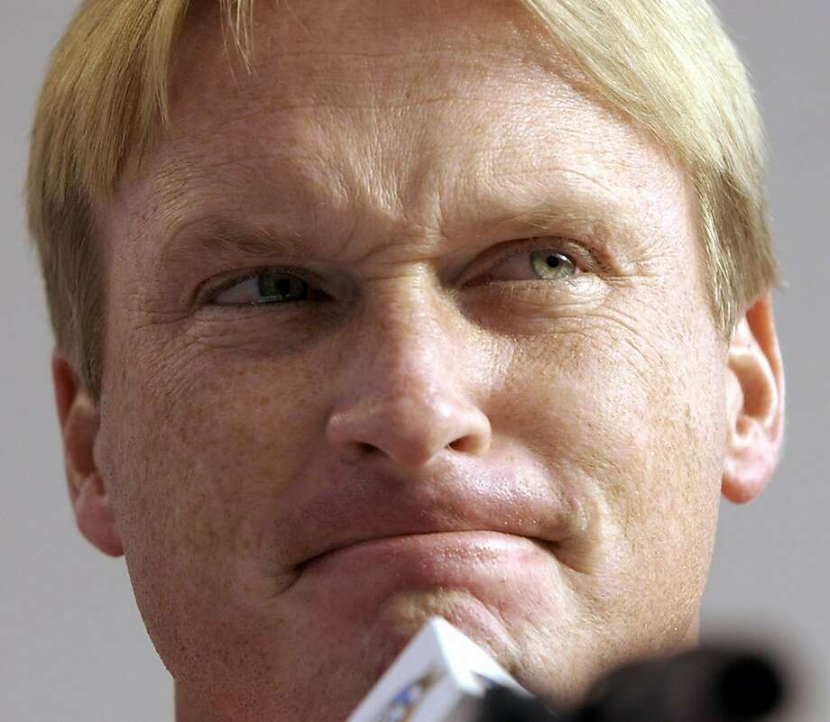 Tampa Bay Buccaneers head coach Jon Gruden answers a question during media day for Super Bowl XXXVII in San Diego, Calif. Tuesday, Jan 21, 2003. Gruden will face his old team, the Oakland Raiders, Sunday, Jan. 26, 2003. (AP Photo/David J. Phillip) Photo: DAVID J. PHILLIP, AP