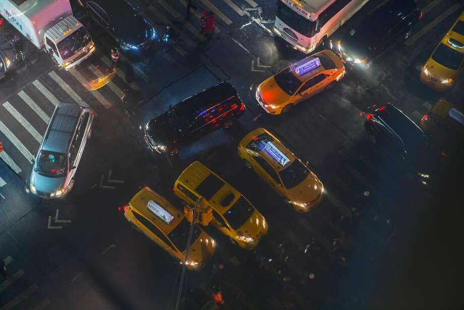 Helped by recent advances in artificial intelligence, researchers can analyze images like these cabs in New Yor and predict political leanings along with income and buying habits. Photo: HIROKO MASUIKE, NYT