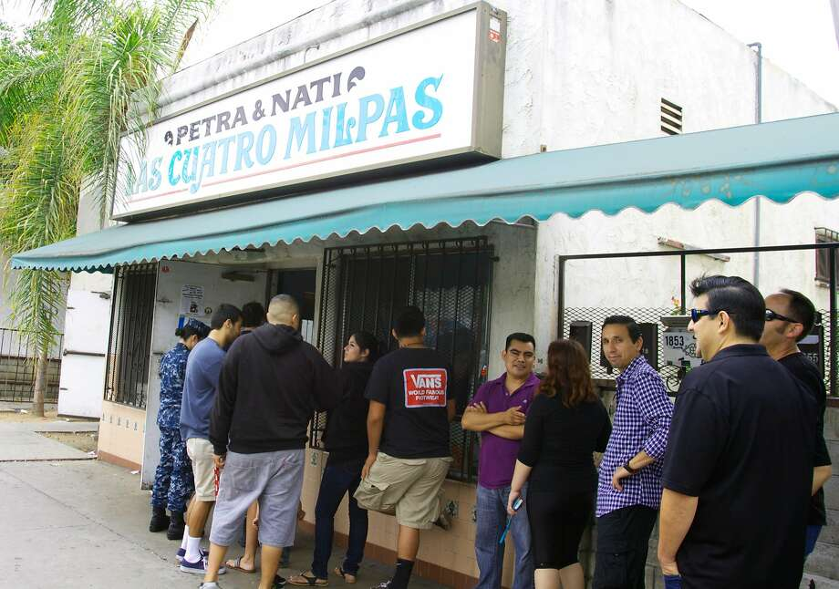 Patrons stand in line at Las Cuatro Milpas, an old-school Mexican restaurant in the Barrio Logan neighborhood of San Diego. Photo: SanDiego.org