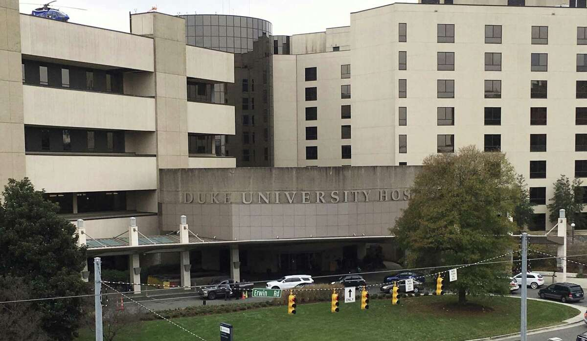 This photo taken Dec. 15, 2017, shows Duke University Hospital, which is part of the Duke University Medical Center in Durham, N.C. A federal anti-trust complaint filed by Dr. Danielle Seaman, a former radiology professor at the university claims that Duke and the nearby University of North Carolina at Chapel Hill conspired to avoid competition by agreeing not to hire talent away from each others medical enterprises. Both Duke and UNC deny the existence of the no-hire agreement.