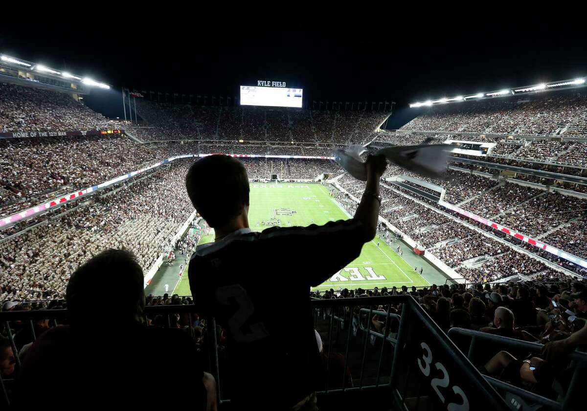 Brayden Holle, 10, of Houston, waves his towel in the 600 level during the third quarter of an NCAA college football game at Kyle Field on Saturday, Sept. 12, 2015. ( Karen Warren / Houston Chronicle )
