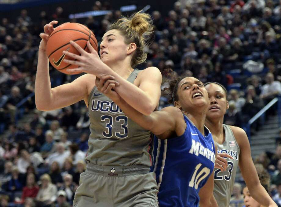 UConn junior Katie Lou Samuelson, left, has become accustomed to the rigors of travel. Photo: Stephen Dunn / Associated Press / FR171426 AP