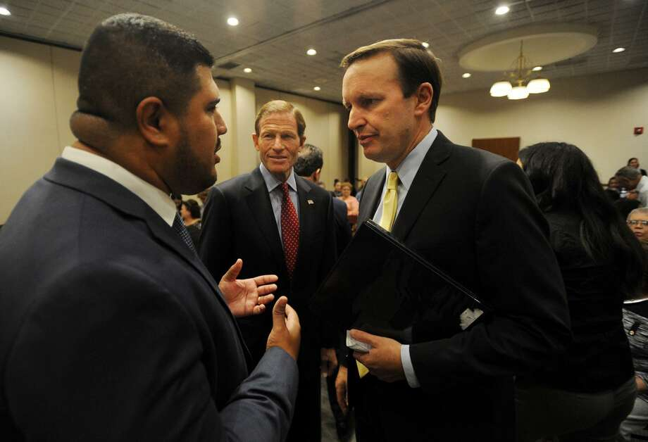 From left; Bridgeport State Rep. Chris Rosario talks with Senators Richard Blumenthal and Chris Murphy at a public meeting concerning the devastation in Puerto Rico at the Margaret Morton Government Center in Bridgeport, Conn. on Wednesday, October 11, 2017. Photo: Brian A. Pounds / Hearst Connecticut Media / Connecticut Post