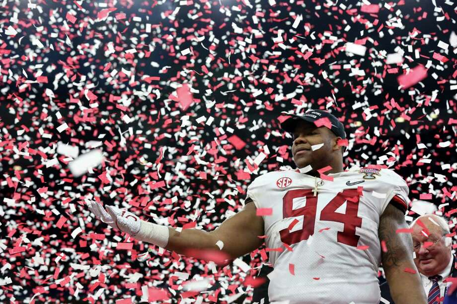 Alabama defensive lineman Da'Ron Payne (94) celebrates after being selected most valuable defensive player, after the Sugar Bowl semi-final playoff game against Clemson for the NCAA college football national championship, in New Orleans, Monday, Jan. 1, 2018. Alabama won 24-6 to advance to the national championship game. (AP Photo/Rusty Costanza) Photo: Rusty Costanza, FRE / FR170655 AP