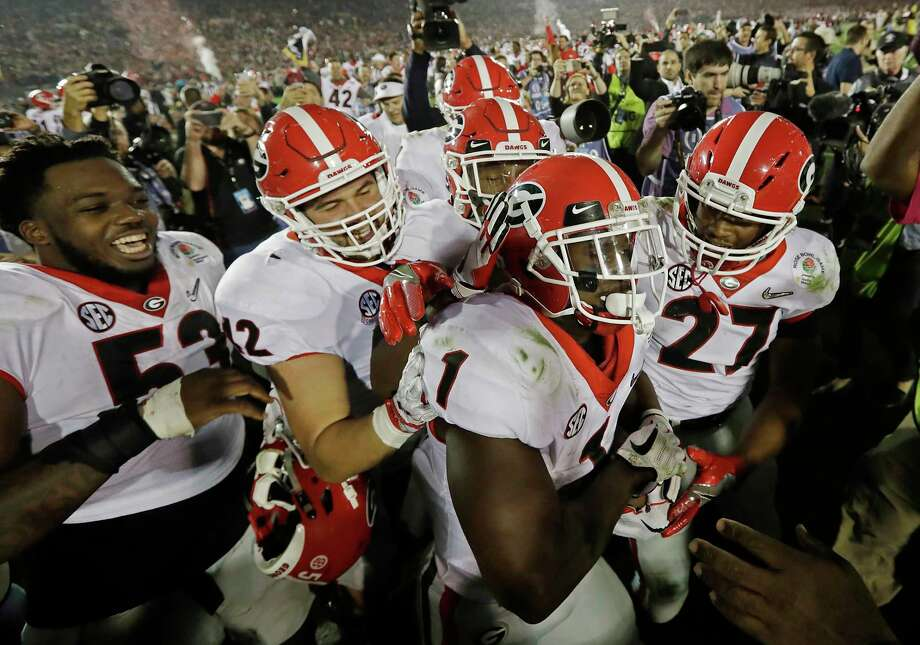 Georgia tailback Sony Michel (1) celebrates with teammates after scoring the game-winning touchdown in the second overtime period to give Georgia a 54-48 win over Oklahoma in the Rose Bowl NCAA college football game, Monday, Jan. 1, 2018, in Pasadena, Calif (AP Photo/Doug Benc) Photo: Doug Benc, STF / Copyright 2018 The Associated Press. All rights reserved.