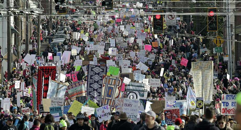 Protesters fill the street on Jan. 21, 2017 during a women's march in Seattle. To trump Trump, such demonstrations in the streets might have to still occur, but there must also be action at the ballot box. Photo: Elaine Thompson /Associated Press / Copyright 2017 The Associated Press. All rights reserved.