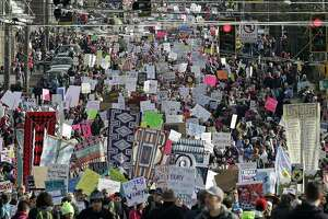 Protesters fill the street on Jan. 21, 2017 during a women's march in Seattle. To trump Trump, such demonstrations in the streets might have to still occur, but there must also be action at the ballot box.