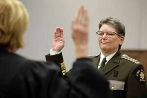 Mitzi Johanknecht is sworn in as King County Sheriff, Tuesday, Jan. 2, 2018 in Seattle. Johanknecht, a veteran of the force, defeated incumbent Sheriff John Urquhart in November.
