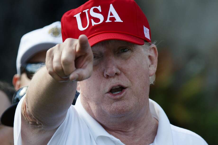 President Donald Trump speaks as he meets with members of the U.S. Coast Guard, who he invited to play golf, at Trump International Golf Club, Friday, Dec. 29, 2017, in West Palm Beach, Fla. (AP Photo/Evan Vucci) Photo: Evan Vucci, Associated Press